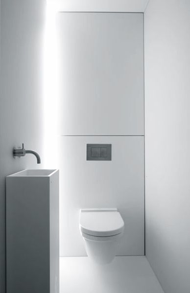 Beautiful white bathroom by Govaert & Vanhoutte Architects.
