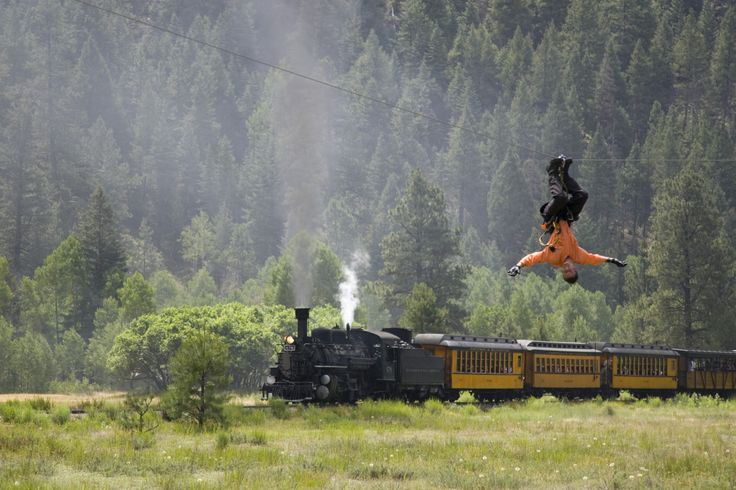 A Sky Ranger soars next to the Durango train at Soaring