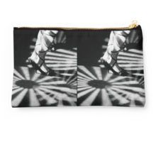 Feet of girl dancing in nightclub lights black and white silver gelatin 35mm film analog photograph Studio Pouch