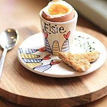 Personalised egg cup and saucer from Gallery Thea.