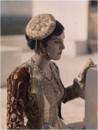 Actress wears costume introduced to region by consort of King Otto.  Keywords: COLOR IMAGE, PHOTOGRAPHY, OUTDOORS, DAY, AUTOCHROME, VINTAGE COLLECTION, ONE PERSON, YOUNG ADULT, YOUNG WOMEN, REENACTMENTS, ACTORS, COSTUMES, ANTIQUITIES, DELPHIC FESTIVAL, SIDE VIEW, PROFILE, SERIOUS, WAIST UP, QUEEN AMALIA, KING OTTO, EMBROIDERY, CAUCASIAN APPEARANCE  Location: Mount Parnassus, Greece.  Photographer: MAYNARD OWEN WILLIAMS/National Geographic Creative