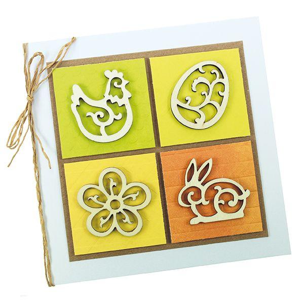 Puukuvioiden avulla koristeltu kortti.
