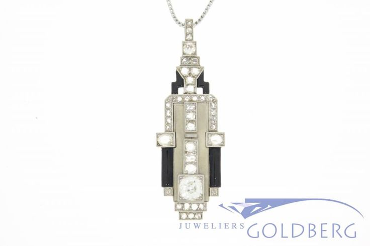 Beautiful antique white gold Art Deco pendant, with 40 rose cut diamonds, and two Bolshevik cut diamonds, one of approximately 0.80ct and one of aproximately 0.18ct.  On 4 points of The pendant is colored with black enamel, creating a beautiful contrast with the white gold. Truly a beautiful piece of jewelry, as would be worn by very wealthy individuals in the 1920s, and arguably worthy of a place in a museum. For more information visit our site…