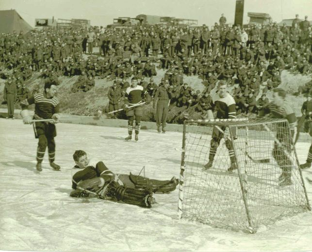 Canadian soldiers serving on the front lines in Korea put down their guns to take part in a hockey game on the frozen Imjin River [643  520]