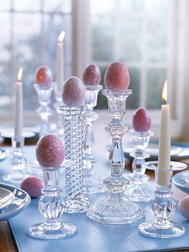 Glittered Easter eggs on glass candlesticks make for an elegant table display!
