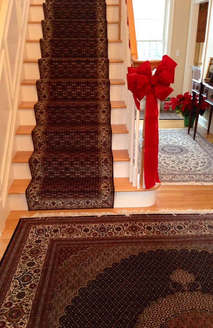 Love the stairs case runner which goes great with the entry way rug.