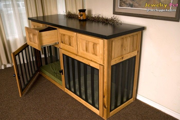 Build dog crate into furniture, much more stylish than a metal crate in your house.
