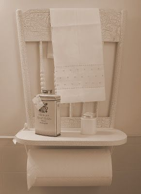 I love this idea! An old chair back and seat are made into a paper towel holder (a piece of ribbon ties the roll onto the chair seat; no hardware required). Vintage treasures are set on the shelf made by the seat and a beautiful towel hangs from chair back. Don't you just love the crackled paint on the back of this chair?