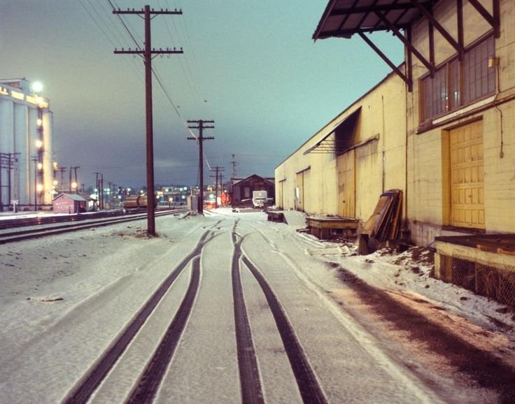 Tracks and Snow near Waterfront, Vancouver, 1980 by Greg Girard.