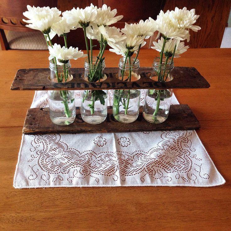 Centerpiece made with an old pop crate and Starbucks frappuccino bottles