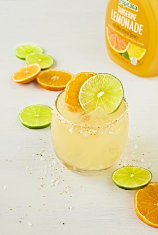 Tangerine Margarita Ingredients: 3 oz. TROPICANA® Tangerine Lemonade ½ oz. Fresh Lime Juice ½ oz. Cointreau 1 oz. Tequila Instructions: Prep a rocks glass by rimming it with citrus salt. Combine all ingredients in a cocktail shaker. Shake well and strain into glass over ice. Garnish with a fresh citrus wheel.