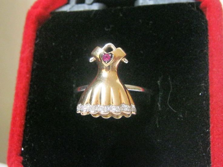 Pippo Perez one of a kind stunning dress ring. The ruby heart has been adopted by the American Red Cross Society.