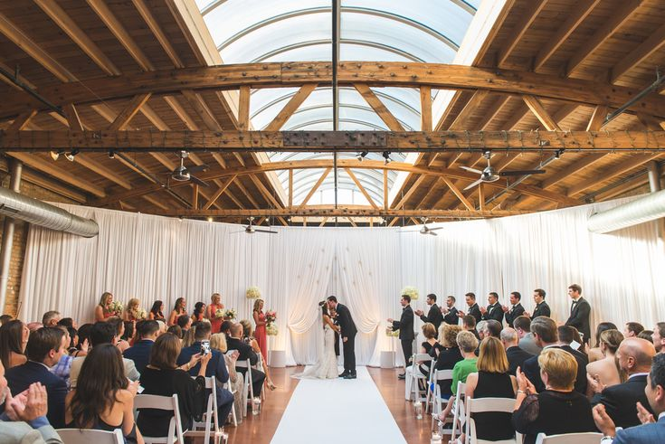 Rustic, industrial chic wedding. Venue: Loft on Lake | Photography: Thara Photo | Planning: Elisa, The Simply Elegant Group | Draping: Art of Imagination | Floral:   Gratitude Heart Garden | Catering: FireFly | Cake: West Town Bakery | Bar: Binny's | Reception: Toast & JamTransportation: Windy City Limo