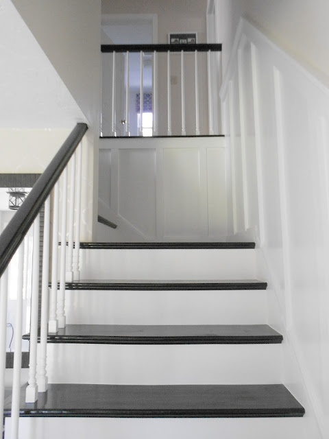 Board and Batten stairway - love the black stair treads too