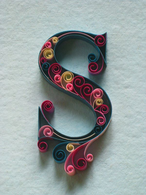 Gorgeous letters made from colored paper.  Possible DIY?