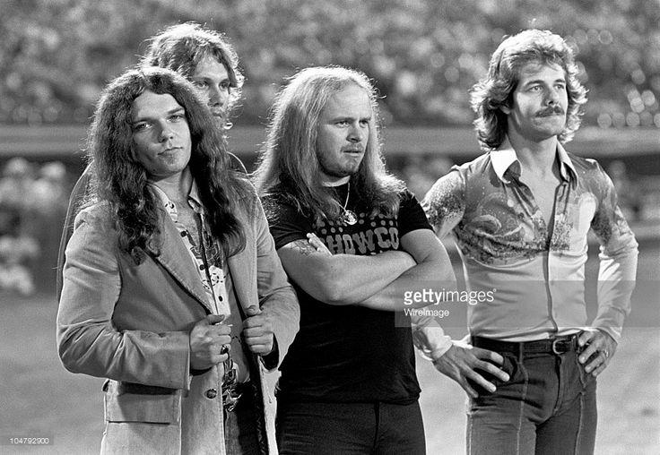 Gary Rossington, Steve Gaines and Ronnie Van Zant of Lynyrd Skynyrd, and Freddie Weller on the field before the Season Opening Atlanta Braves Game