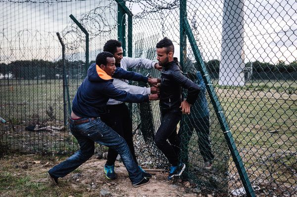 Migrants in Calais Desperately Rush the Channel Tunnel to England, Night After Night - The New York Times,  July, 2015