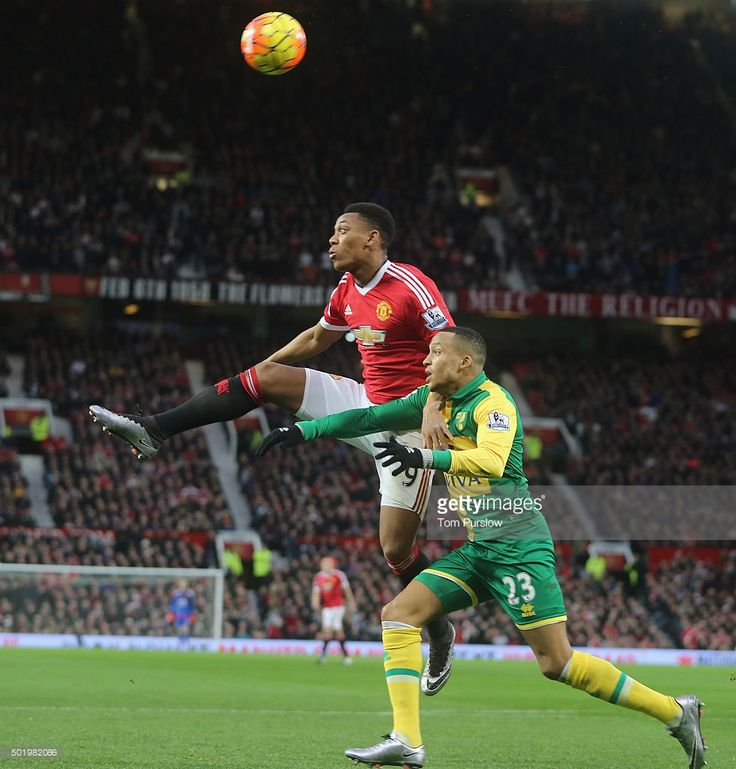 Anthony Martial of Manchester United in action with Martin Olsson of Norwich Cityi...
