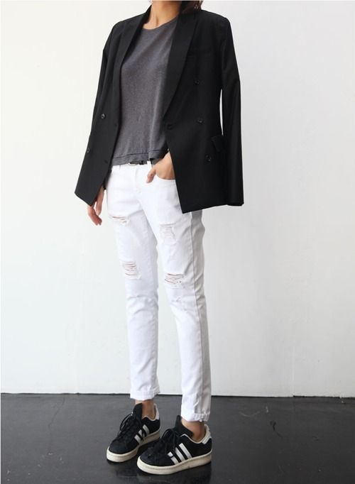 Shop this look for $84:  http://lookastic.com/women/looks/black-double-breasted-blazer-and-charcoal-crew-neck-t-shirt-and-white-skinny-jeans-and-black-and-white-low-top-sneakers/2444  — Black Double Breasted Blazer  — Charcoal Crew-neck T-shirt  — White Ripped Skinny Jeans  — Black and White Suede Low Top Sneakers