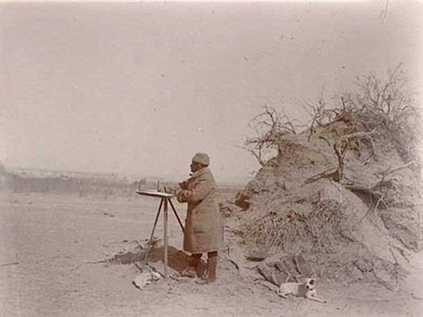 Sir Aurel Stein at his plane table surveying in the Taklamakan Desert. © The British Library