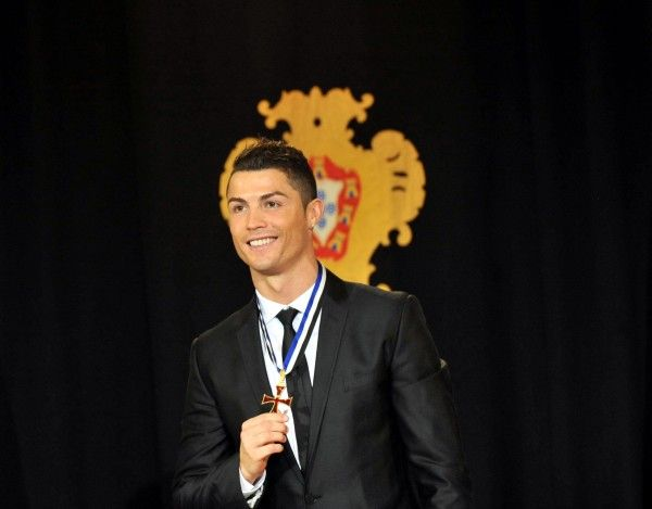 Portuguese football super star Cristiano Ronaldo poses after being awarded the Grand Officer of the Order ...