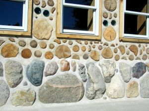 Cordwood construction featuring old bottles in the walls