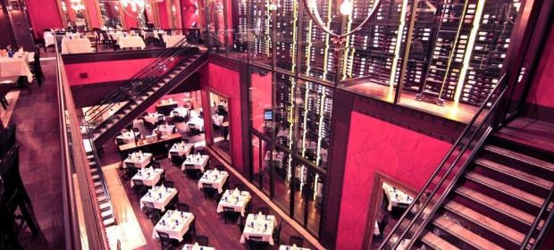 """Texas de Brazil steakhouse, Chicago. Amazing! Three storey wine """"cellar"""" has an acrobat dancing on wires when she isn't swinging over to get a bottle! Huge buffet, excellent food, giant flower center piece, and handsome young men bringing you meat--cannot ask any more from a restaurant!"""
