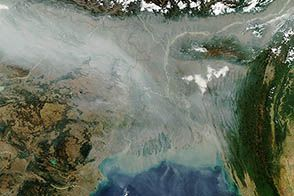 A River of Haze : NASA Earth Observatory - As is often the case in the winter, a thick river of haze hovered over the Indo-Gangetic Plain in January 2013, casting a gray pall over northern India and Bangladesh. On January 10, the Moderate Resolution Imaging Spectroradiometer (MODIS) on NASA's Aqua satellite captured this image of haze hugging the Himalayas and spilling out into the Ganges delta and Bengal Sea.