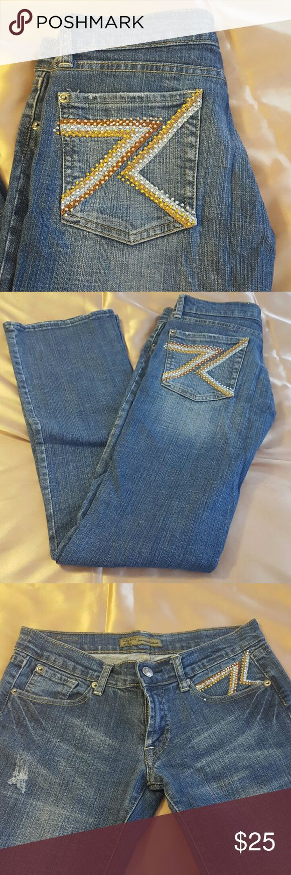 Kelley #007 low waist bootcut size 28 Very cute bootcut blue jeans. with beautiful embroidery and metallic design on back pockets and in front. Use once it's in a great condition. Kelley 007 Jeans Boot Cut