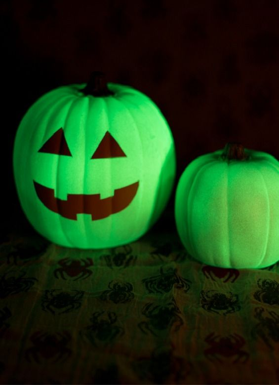 These DIY Halloween glowing pumpkins will look so cool on your front porch come Halloween night. The perfect creepy crawly feel for spooky holiday decor!