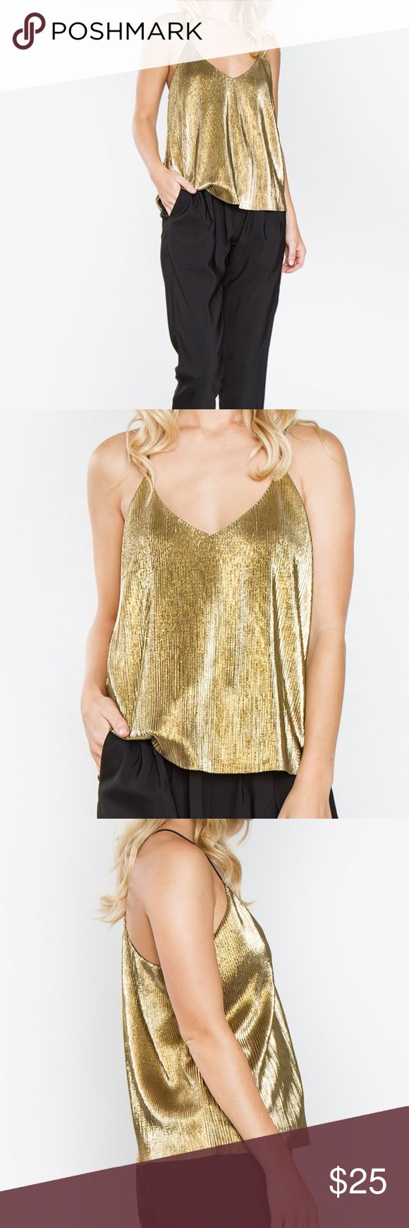"NWT Gold Metallic Tank Top Gold Metallic Tank Top  *Pleated Metallic Cami with Thin Strap Detail  *V Neck Line  *Lined  *100% Polyester  *Color: Gold  *Hand Wash Cold and Dry Clean        Size and Fit  *Model is wearing a Small  *Length: 19""  *Chest: 34.5"" Tops Tank Tops"