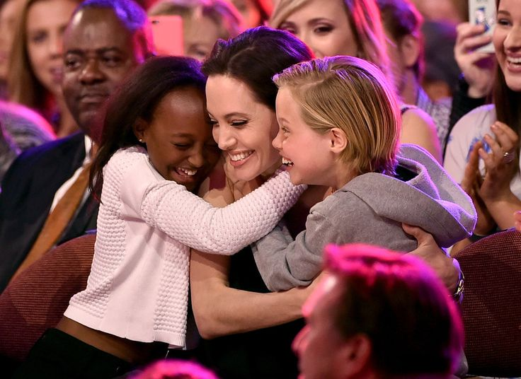 Actress Angelina Jolie hugs Zahara Marley Jolie-Pitt (L) and Shiloh Nouvel Jolie-Pitt (R) after winning award for Favorite Villain in 'Maleficent' during Nickelodeon's 28th Annual Kids' Choice Awards held at The Forum on March 28, 2015 in Inglewood, California.