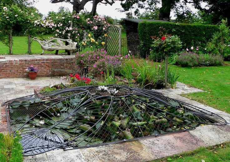 A bespoke child safety pond cover made from galvanized for Garden pond specialists