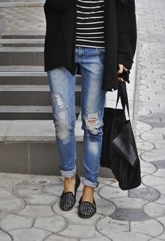 distressed boyfriend jeans, black and white striped top, thick knit cardigan, leather tote bag and studded loafers.