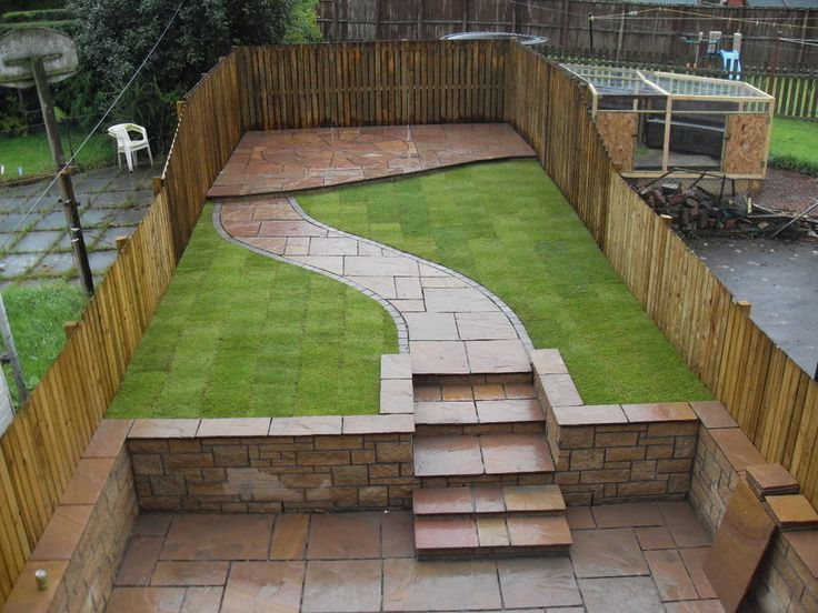 Tiered garden with paved path and steps - by Aspen Landscapes. Make your home design dreams come true. Read reviews of 1000s of trusted tradesmen across the UK and get free quotes on MyBuilder.com.