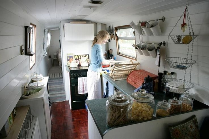 Ikea family: Life on a houseboat - We've used the walls and ceilings for hooks and rails. Open shelving rather then cupboards creates more space.