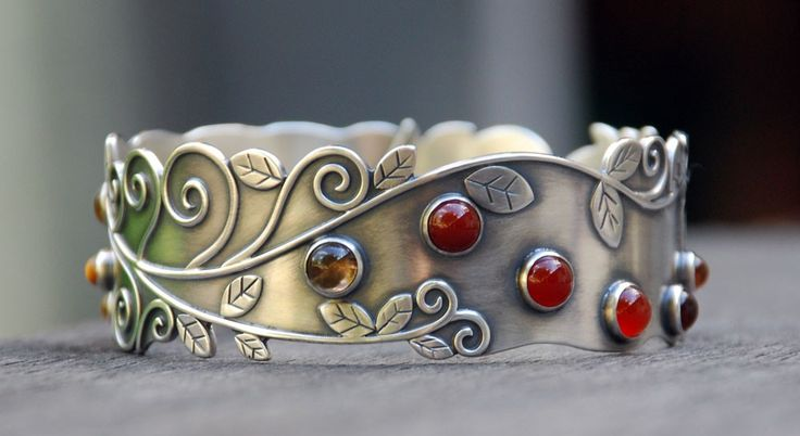 Sterling silver bangle bracelet with vine motif and cabochons of carnelian, tigers eye and quartz by SpiralStone Designs