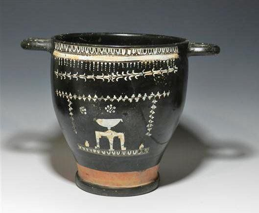 Greek Gnathian skyphos, 4th century B.C. Black ware, decorated with added painted decorations of grape vines and an altar, 22-5 cm high. Private collection