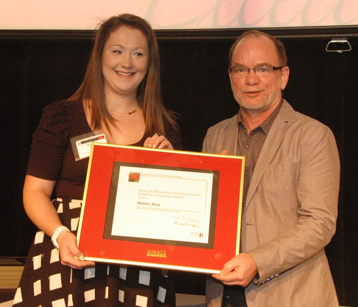 Bridget Moir, winner of the Honourable Mention Essay Prize at the 2000 Level, with John Spencer, Chair of the Writing Department.