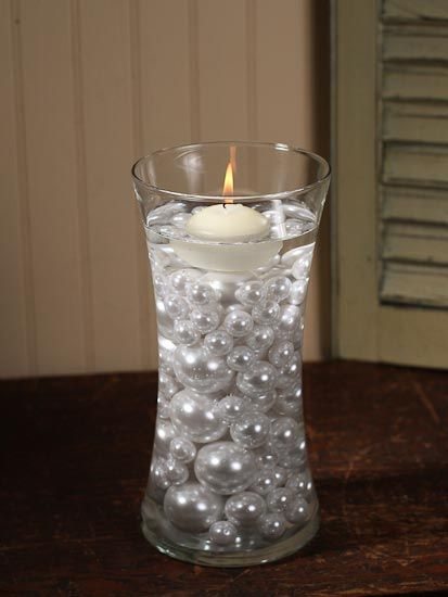 three different sized pearls, and floating candle in beautiful cyclinder