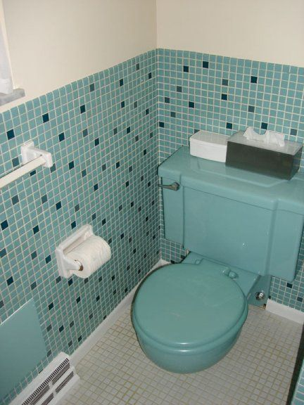 Great tile and a wall-mount toilet from the 1950s or early 60s.