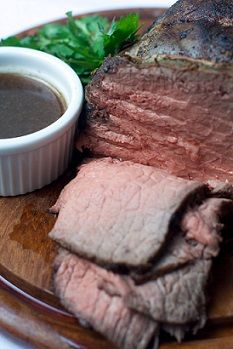 """Au jus is French for """"with the juice."""" In America it describes a thin sauce for using with beef. Au jus recipe to enhance beef from Real Restaurant Recipes sauce and beef recipe collection."""