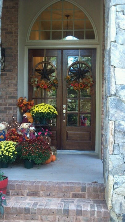 cozy rustic front porch with a beautiful door