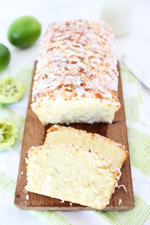 Coconut Lime Loaf Cake Recipe on twopeasandtheirpod.com This simple coconut lime loaf cake is drizzled with a sweet lime glaze and topped with toasted coconut!