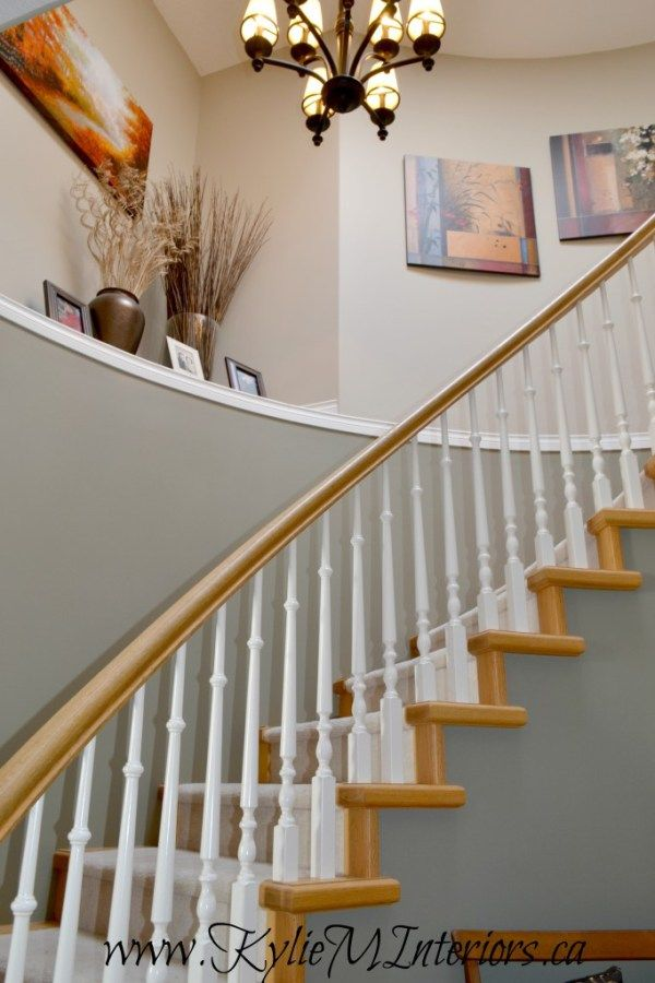 best paint colours for a stairwell with a light or yellow toned oak railing and risers.  benjamin moore Sandy Hook Gray and Gettysburg Gray