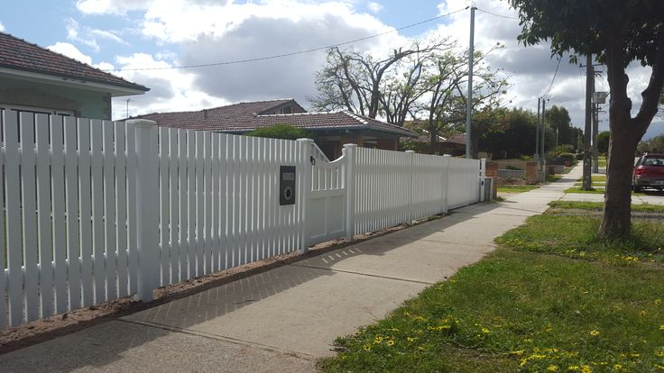 flat top picket fence, square pickets and ornate gate.