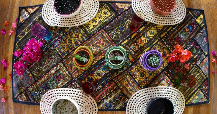 Vintage embroidered table runner #kutchembroidery #grasstablemats #smoochceramics #beadedbasketplanters #bohemiandecor #bohemiantabledecor