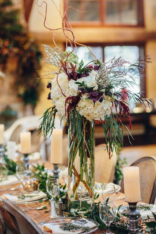 Tall wedding centerpiece idea - tall, glass vessels with white hydrangeas, burgundy flowers and greenery {Copper & Birch}