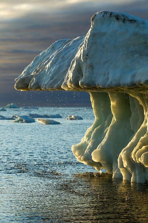 Manitoba, Canada ~ Melting iceberg on Hudson Bay at sunset on sunny summer evening. Photo © Paul Souders
