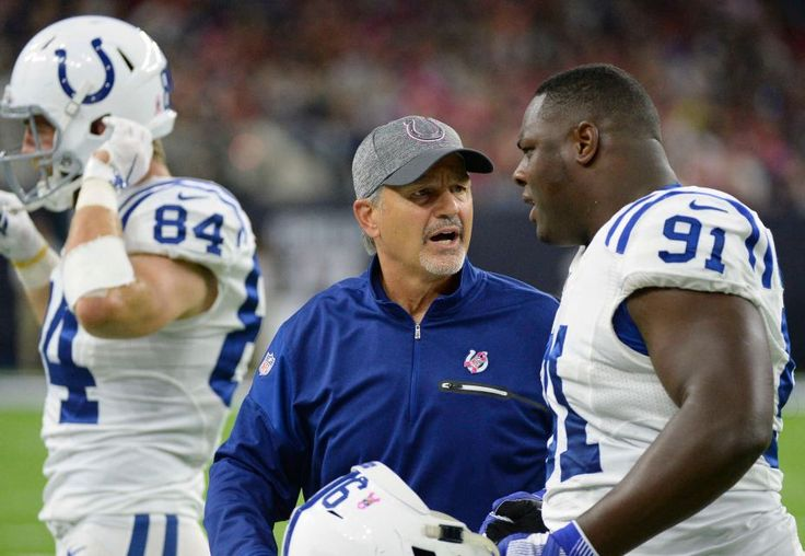Colts vs. Texans:   October 17, 2016   -  26-23, Texans  -    Indianapolis Colts head coach Chuck Pagano, center, talks with Hassan Ridgeway (91) during the first half of an NFL football game against the Houston Texans, Sunday, October, 16, 2016, in Houston.